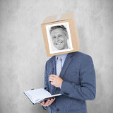 Composite image of businessman with photo box on head Stock Photos