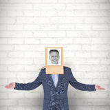 Composite image of businessman with photo box on head Royalty Free Stock Image