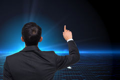 Composite image of businessman pointing Stock Images