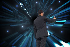 Composite image of businessman pointing Stock Photography