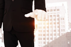 Composite image of businessman pointing with finger Stock Images