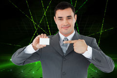 Composite image of businessman pointing at his businesscard Stock Photo