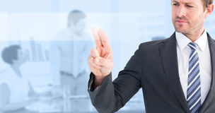 Composite image of businessman pointing with his finger Stock Photo