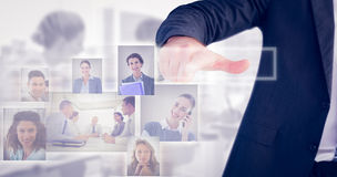 Composite image of businessman pointing with his finger stock images