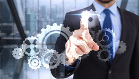 Composite image of businessman pointing his finger at camera Royalty Free Stock Photos