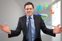 Composite image of businessman posing with arms out Stock Images
