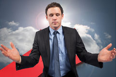 Composite image of businessman posing with arms out Royalty Free Stock Photography