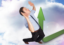 Composite image of businessman posing with arms raised Stock Images