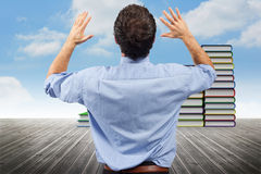 Composite image of businessman posing with arms raised Stock Photography
