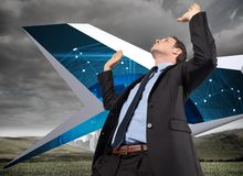 Composite image of businessman posing with arms raised Royalty Free Stock Image