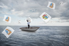Composite image of businessman posing with arms up in a sailboat Royalty Free Stock Photos