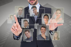 Composite image of businessman presenting number six with his fingers royalty free stock image