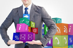 Composite image of businessman presenting your product with hands Stock Image