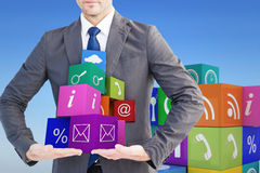 Composite image of businessman presenting your product with hands Royalty Free Stock Photography