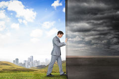 Composite image of businessman pushing away scene Stock Photography