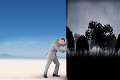 Composite image of businessman pushing away scene Royalty Free Stock Images