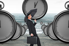 Composite image of businessman pushing the wind with umbrella Royalty Free Stock Photography