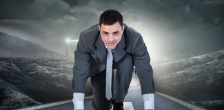 Composite image of businessman ready to race Stock Photography