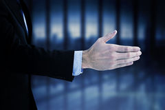 Composite image of businessman ready to shake hand Stock Images