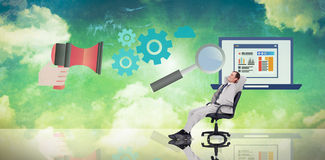 Composite image of businessman relaxing in swivel chair Stock Images