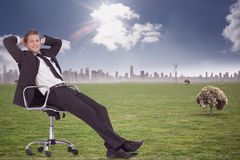 Composite image of businessman relaxing in swivel chair Stock Photography