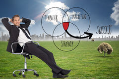 Composite image of businessman relaxing in swivel chair Stock Photo