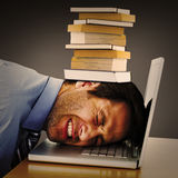 Composite image of businessman resting head on keyboard Royalty Free Stock Image