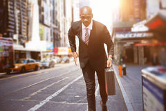 Composite image of businessman running royalty free stock image