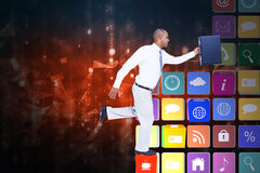 Composite image of businessman running with briefcase Stock Photo