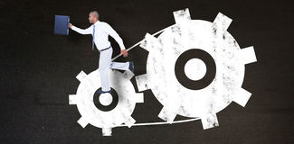 Composite image of businessman running with briefcase Royalty Free Stock Image