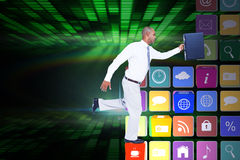 Composite image of businessman running with briefcase Royalty Free Stock Photos