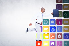 Composite image of businessman running with briefcase Stock Photos