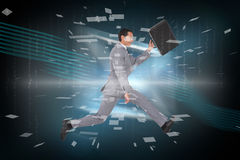 Composite image of businessman running with a suitcase Stock Photo