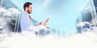Composite image of businessman scrolling on his digital tablet Stock Photography
