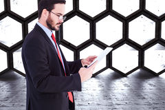 Composite image of businessman scrolling on his digital tablet Stock Photo