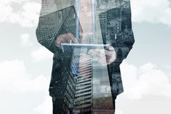 Composite image of businessman scrolling on his digital tablet Royalty Free Stock Image