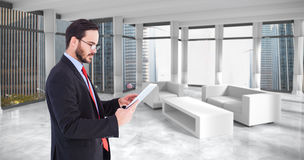 Composite image of businessman scrolling on his digital tablet Royalty Free Stock Images