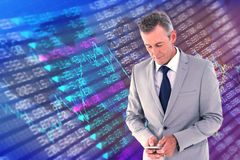 Composite image of businessman sending text. Businessman sending text against stocks and shares Royalty Free Stock Photo