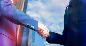 Composite image of businessman shaking hands Royalty Free Stock Photography