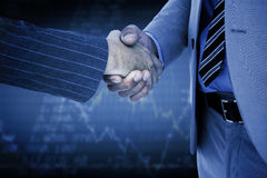 Composite image of businessman shaking hands with a co worker Stock Image