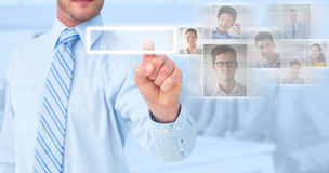 Composite image of businessman in shirt pointing with his finger. Businessman in shirt pointing with his finger against blue background stock photography