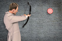 Composite image of businessman shooting target Royalty Free Stock Image