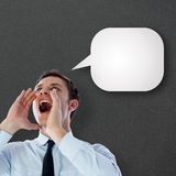 Composite image of businessman shouting. Businessman shouting against speech bubble Royalty Free Stock Photography