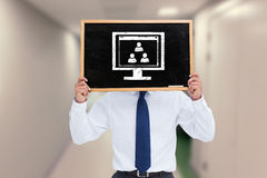 Composite image of businessman showing board Stock Image