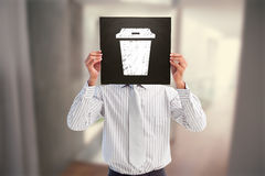 Composite image of businessman showing board Royalty Free Stock Photography