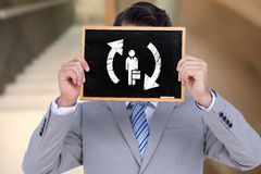 Composite image of businessman showing board Royalty Free Stock Photos