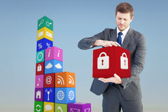 Composite image of businessman showing something with his hands Stock Images