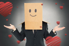 Composite image of businessman shrugging with box on head Stock Photography