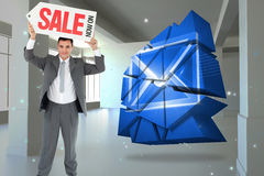 Composite image of businessman with sign above his head Royalty Free Stock Image