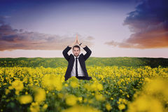 Composite image of businessman sitting in lotus pose with hands together Royalty Free Stock Photos